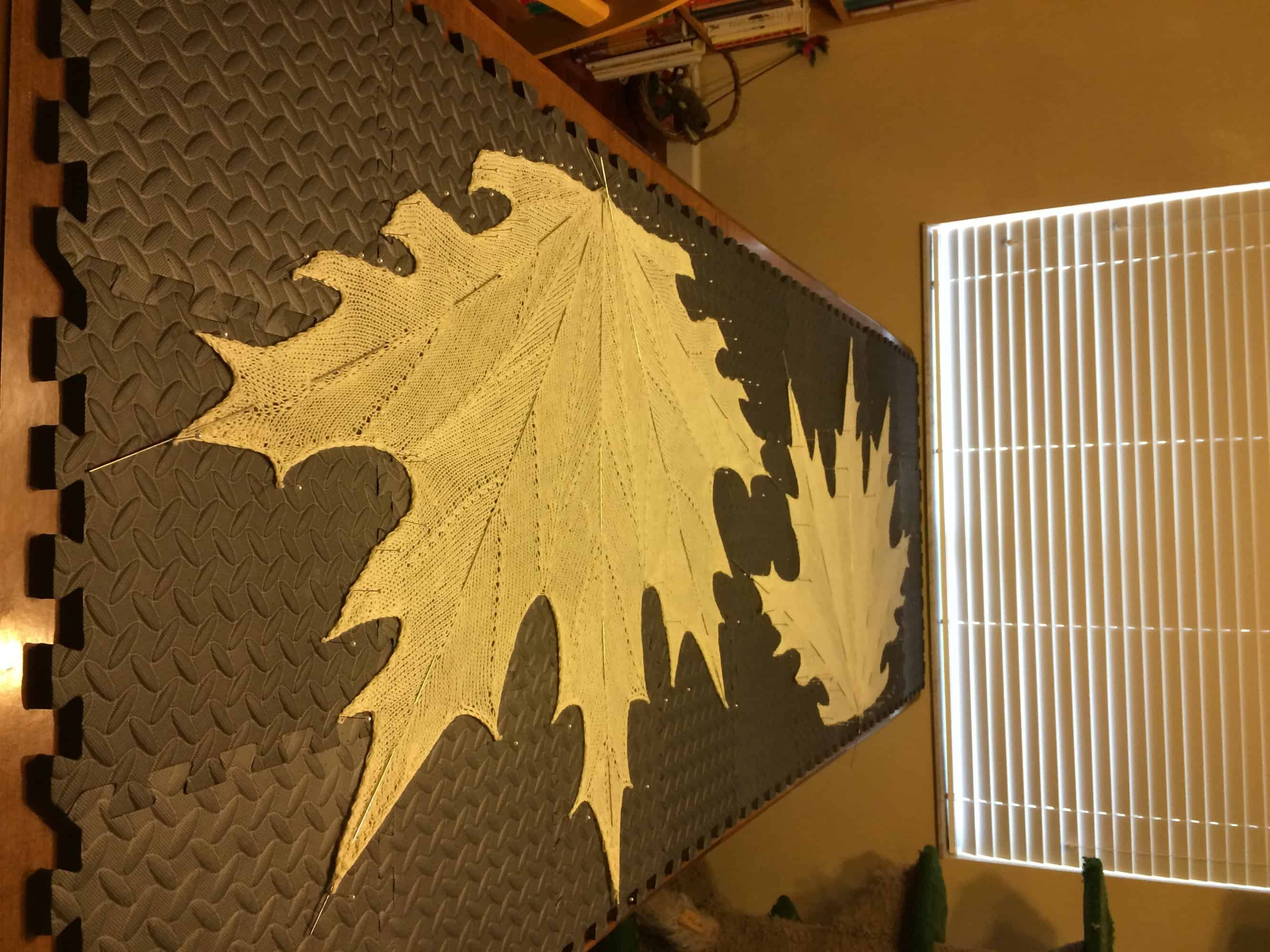 Two of the Seven MAPLE LEAF Shawls knit by greenegirl between February and September 2014.